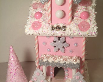 Lighted  pink and white candy house.