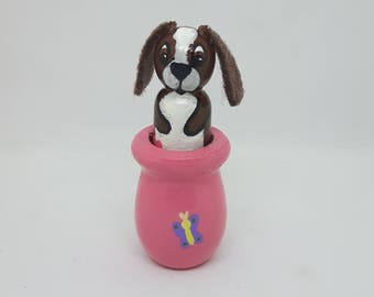 Miniature Basset Hound in a flower Pot