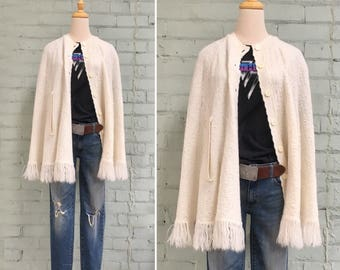 1970s cream knit poncho / 70s button front sweater cape / 1970s cream fringe poncho