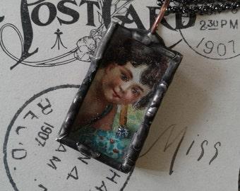Soldered vintage cherub postcard shadow box necklace
