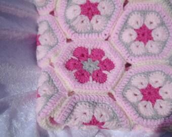 African flower motif, hand crocheted pram blanket