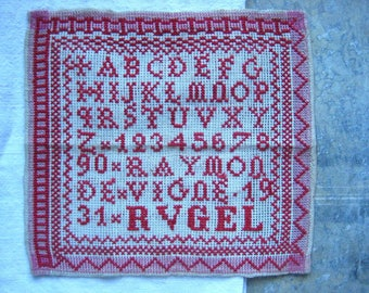 a vintage French red work sampler, alphabet sampler, 1931, stitched sampler