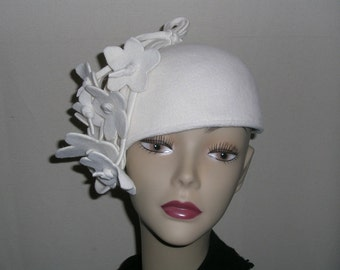 Winter White Casque with a cascade of flowers
