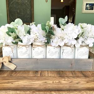 Mason Jar Centerpiece With Hydrangeas And Eucalyptus