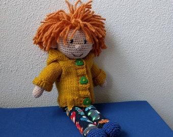 Cheerful, redhead, crocheted doll.