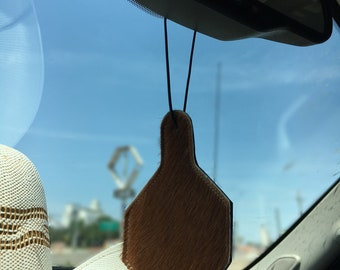 cowhide and leather car freshener with 1oz bottle of scented oil