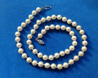 "Vintage! Necklace, 21"" long single strand costume white pearl, 5/16"" in diameter."