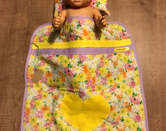 Yellow floral doll with heart blanket