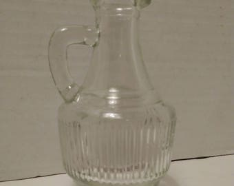 Very small, vintage, clear glass vase with handle and pour spout. Ribbed. Very cute, easy re-purpose