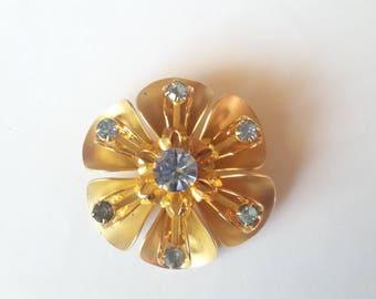 Vintage flower brooch periwinkle blue rhinestones and gold tone