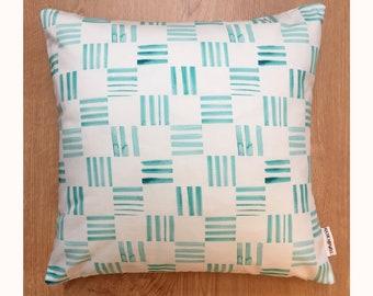 Geometric pattern cushion in hand-painted Check Aqua printed fabric