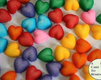 """56 rainbow edible sugar hearts, 8 each of 7 colors. 1/2"""" across, Cupcake toppers first birthday or baby shower mini cupcake decorations."""