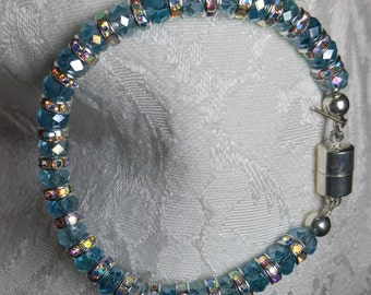 Dolphin: Aqua tone beads with silvertone spacers, magnetic clasp. SimplyElegantKathy