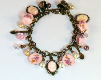 SALE! Tiny pink china flowered tea charm bracelet, pink lady cameo charms, antique brass cup, spoon charms, china cup, saucer