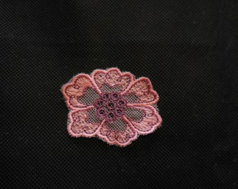 A Small piece of pink purple floral lace applique / shoes lace motif is for sale. sold by per piece