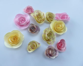 12 roses in pink paper, pink, yellow flowers liberty