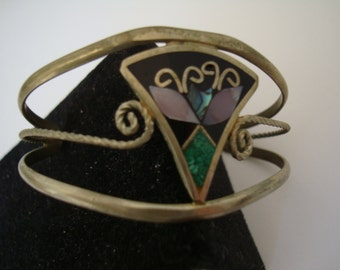 2 1/2 inch.bangle bracelet.  condition: plating looks dull. ..
