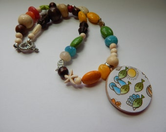 Really cute beachy one of a kind collage necklace.