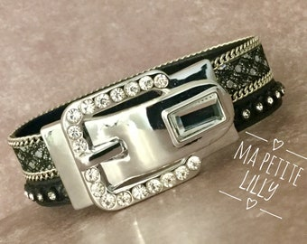 Bracelet with a rhinestone black leather and leather thong costume jewelry ring