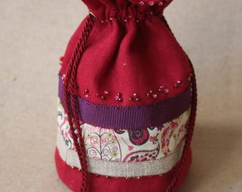 Small pouch shaped bag in a Bohemian spirit. Valentines Day gift idea. Lucky charm.