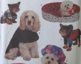 Simplicity 8928 -- Dog bed covers in 4 sizes and coats in small, medium and large. Pattern is uncut and factory folded.