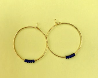 Creoles in Golden brass and marine blue beads