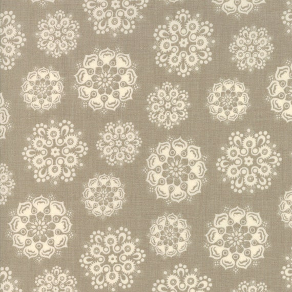 Fancy Delicate Doily Snowflakes on Grey Background Petites Maisons De Noel by French General Fabric by the Yard Moda Fabrics 13793 14