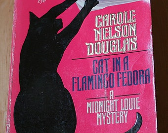 Cat In A Flamingo Fedora by Carole Nelson Douglas--Tom Doherty Associations 1997-- Forge Paperback 1998 1st Printing--Shipping Included