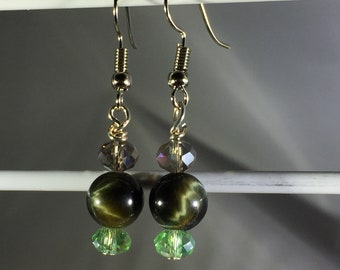 Olive Green cat's eye 8mm with green and tan crystals. French Hook.