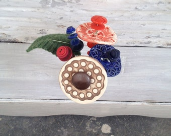 brown, dark blue/cobalt, and orange button flower bottle bouquet