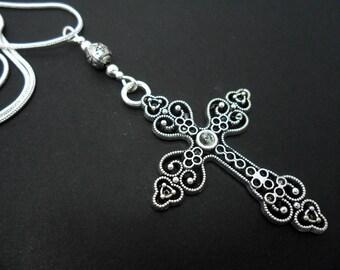 A lovely cross themed  tibetan silver  pendant necklace.