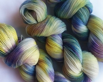 Hand dyed yarn, Clematis, 75/25 super wash merino wool/nylon sock yarn, purple yarn, yellow yarn, blue yarn, green yarn