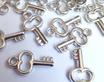 10 acrylic silver key charms 17x9mm
