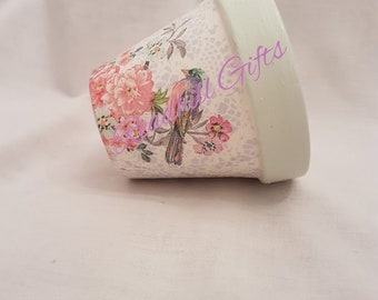 Hand decoupaged plant pot decorated with tropical birds and flowers