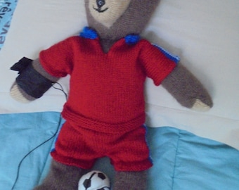 Brown Teddy bear knitted hand player of soccer