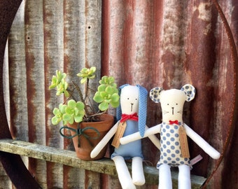 Sisters Three and me are handmade cloth dolls with a unique style.