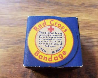 Vintage Red Cross Bandages in the box.