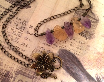 Rock Candy Necklace. Amethyst and citrine large rough chips strung on antique brass color copper wire, and attached to antiqued brass chain.