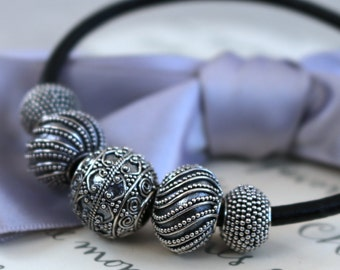 Sterling Bali bead, Pandora style bracelet on Black Leather Cord, 5 graduated large hole beads