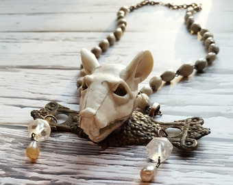 Faux mouse skull necklace, (oddities, odd art)