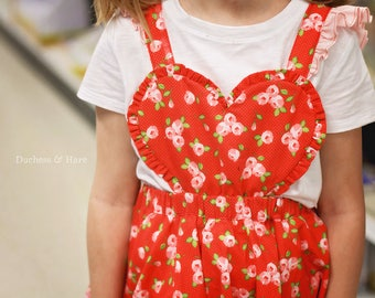 A La Heart suspender skirt or romper with heart bib and ruffles