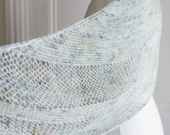 Reversible shawl or scarf in a crescent shape, hand knit lace in pretty pale blues and greens, made with artisan dyed merino & silk yarn