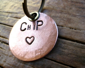 Chipper Tails: Brass/copper ID tag, number(s) on back