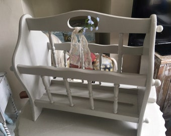 Storage rack for your magazines, Newspapers adorned with blue flowers and lace