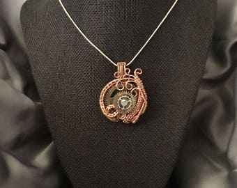 Hand made one of a kind wire wrapped clock gear pendent