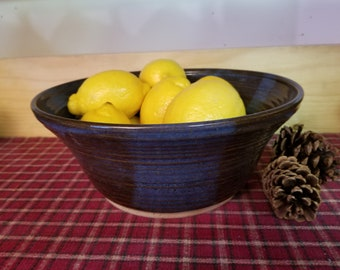 Floating blue pottery bowl