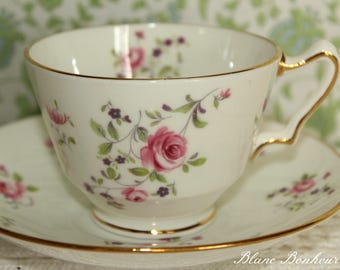 Crown Staffordshire, England: Tea cup and saucer with charming pink flowers