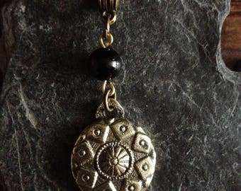 Small brass shield with Onyx bead pendant