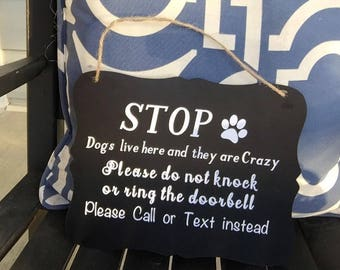 Doorbell sign for dogs