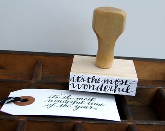 """Hand Lettered Holiday Stamp, Handwritten Calligraphy, Rubber Stamp """"it's the most wonderful time of the year"""" Christmas Stamp"""